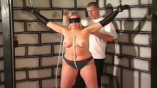 Obedient Babe Stands And Endures Breast Bondage Porn