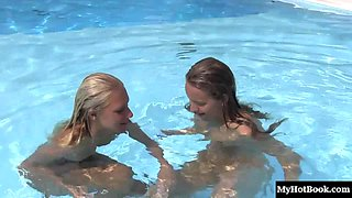 Swimming together in the pool before licking each other's pussies
