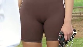 Two sporty girls flash their cameltoe in the street