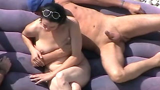 Just a group of horny people on the nudist beach spied on cam
