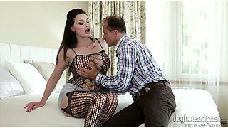 Astonishing brickhouse brunette in fishnets gets her vag licked