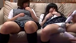 Two adorable Japanese schoolgirls are made to cum hard with